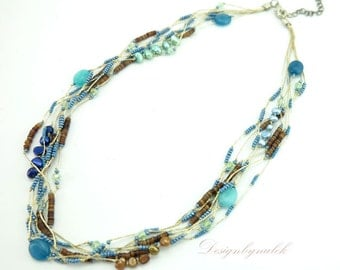 Turquoise,freshwater pearl on silk necklace.