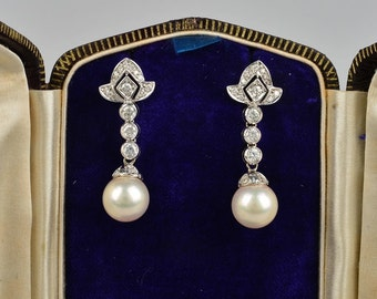 A fabulous pair of vintage 1.20 Ct diamond and pearl swing earrings