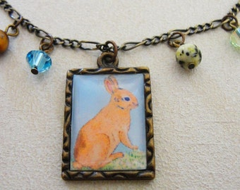 Antique Brass Framed Bunny Rabbit Necklace with Semi Precious Beads and Crystals.