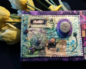 Mixed Media Quilt on canvas, wall art, cotton fabric with paper ephemera,  beads, polymer clay, needle felted wool