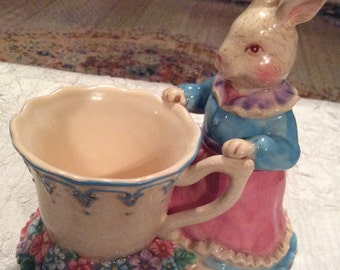 Adorable Vintage Colorful Mama Bunny in Front of Cup in Flower Garden with Beautiful Vintage Crazing