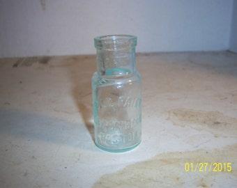 1890's Bromberg Boston, Mass Gold Paint Aqua 2 3/4 inch bottle