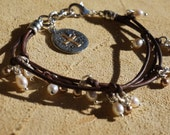 Knotted Leather and Pearl Multi Strand Bracelet, Silver Artisan Charm