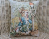Beatrix Potter ..Peter Rabbit and the Carrots 12 x 8 Pillow.