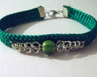 Green Kumihimo Bracelet with Chainmaille and Millefiori bead embellishment