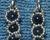 Beautiful deep blue Lapis Lazuli gemstones, surrounded by silver sead beads, with .925 silver French ear hooks