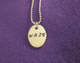 "Beatles song ""Wait"" necklace"