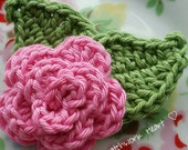 Medium sized deep pink crochet flower brooch with 2 leaves