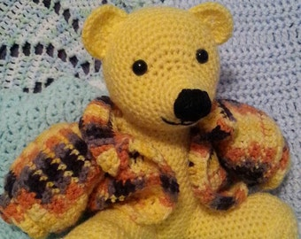 Yellow bear with winter coat