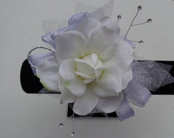 Corsage and matching boutonniere in gardenias trimmed in silver or gold