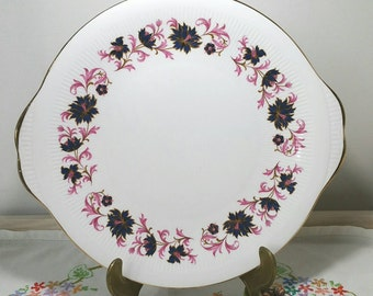Vintage cake plate made by Paragon in the michelle pattern with deep pink and blue leaves. 1950s.