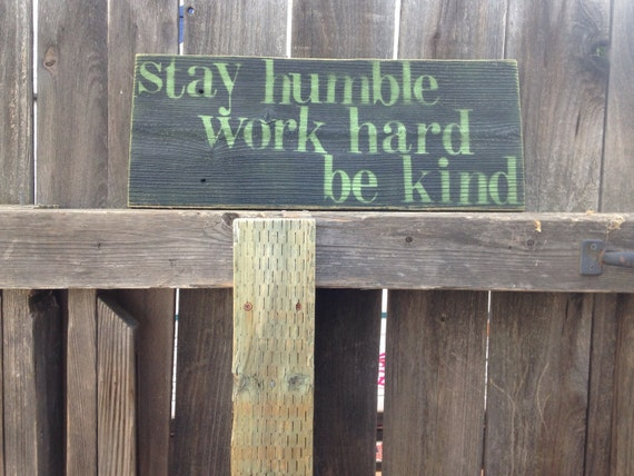 Black and green wooden sign-stay humble work hard be kind