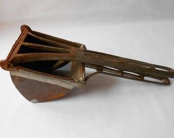 Antique Henis?  Masher Press Strainer