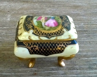 Tiny vintage jewelry box with gold legs