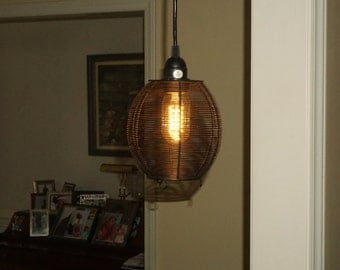 Pendant light Edison styled bulb married to a re purposed metal basket. Chic design and compact. I'll consider your offer!