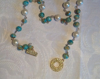 Turquoise and terracotta glass and freshwater pearl gold necklace.