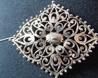 A large metal ornate statement piece brooch by vintage makers HOLLYWOOD