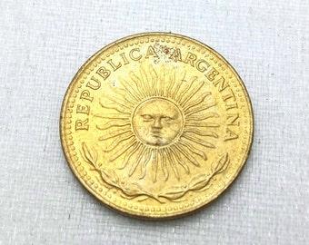Vintage Argentina one peso Sunburst coin