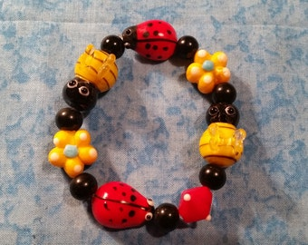 Lamp Work Bumble Bee and Lady Bug Stretch Bracelet