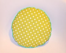 Green and white round polka dots cushion
