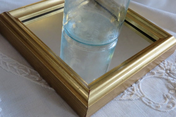 Small triangular wall mirror gold leaf by for Small gold framed mirrors