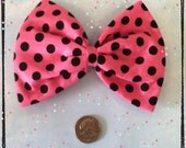 Large pink with black polka dots hair bow