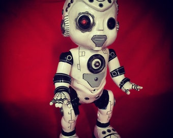 AI-613 is a OOAK robot cyborg baby art doll