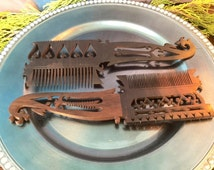 Choice of Vintage Hand-carved Indian Combs with decorative motifs.