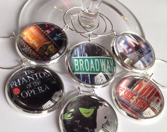 Broadway show glass wine charms featuring Wicked, Lion King, Phantom of the Opera, Rent, a perfect gift for the theater lover