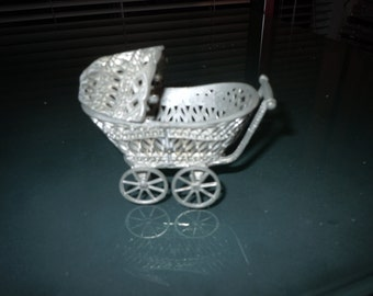 Vintage three and half inch fillagree toy baby stroller