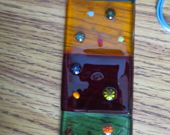 Fused glass suncatcher for spring and summer.  Different colored glass blocks embelished with flowers great mothers day gift.