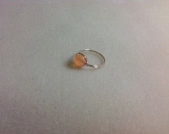 Frosted orange glass ring