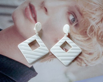 1960s Plastic Clip Earrings Ivory colors. for hipsters or a young graduate