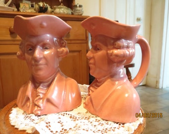 Two identical pink jugs