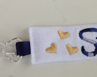 Pacifier clip personalized with name - Blue or Pink with yellow hearts