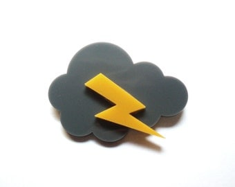 Cloud-shaped brooch with thunderbolt made of gray and yellow plexiglas