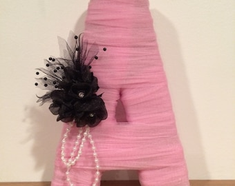 "Personalized Tulle wrapped letter. Letter size is 12""."