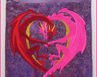 Machine embroidered, handmade, padded, Kindle e-reader cover, entwined dragons in the shape of a heart, fleece lined, measures 9.5in x 6.5in