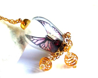 Butterfly necklace pendant necklace glass globe and red rose on golden cage