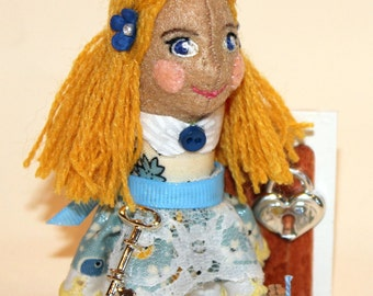 """Alice in Wonderland. Handmade from recycled materials.   Approx 4.25"""" tall &1 1/8 oz weight. From Alice in Wonderland Set Collection"""