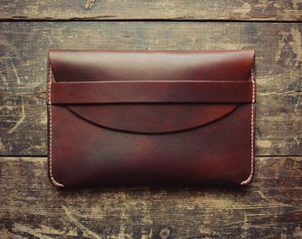 Veg tanned leather flapped folio/clutch bag.