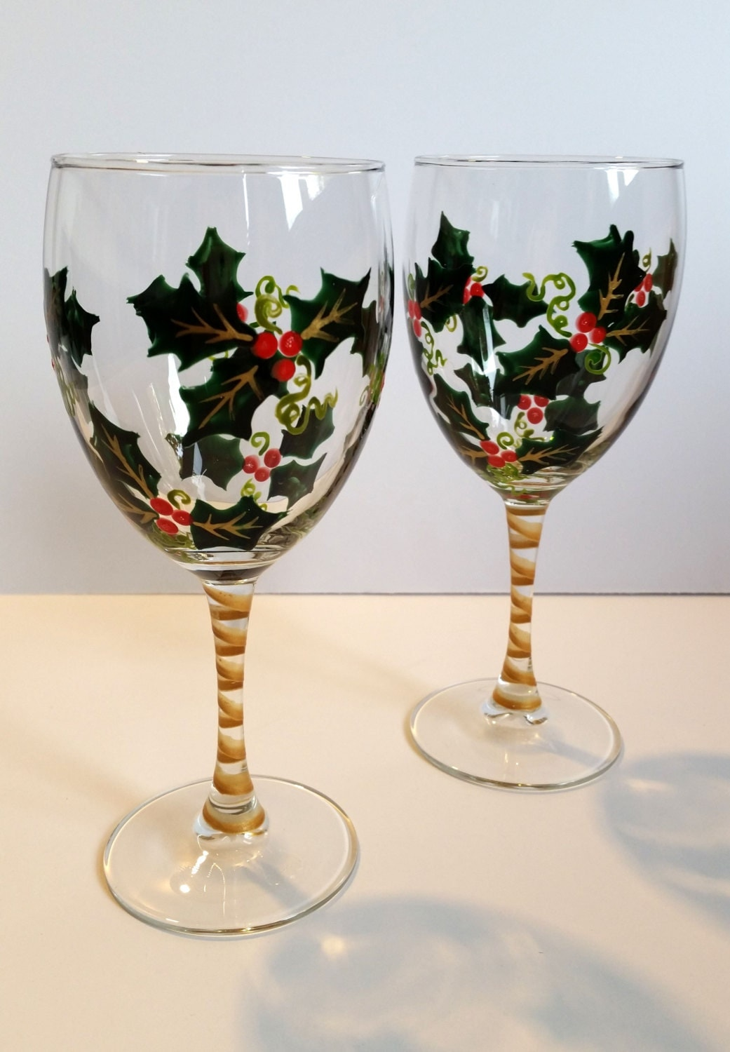 Wine glasses hand painted holly holiday wine glasses set for Hand painted wine glass christmas designs