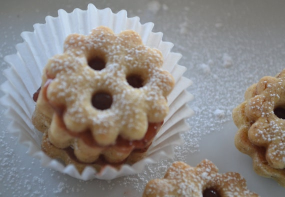 Items similar to LINZER COOKIE - Spiced and filled with raspberry jam ...