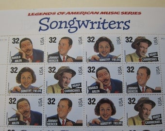 Full unused sheet of  twenty 32 cent 1995 American Music Songwriters USPS postage stamps in mint condition.