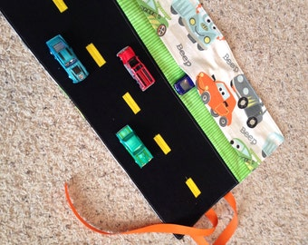Roll up and take anywhere toy car carrier with roadway