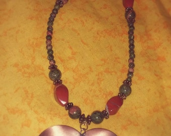 Stunning Large Copper Heart Pendant Necklace With Olive Green and Rust Colored Beads