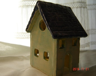 Small ceramic house for garden or home