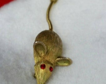 Goldtone Rat Pin Jewelry with Red Rhinestone Eyes and Segmented Tail