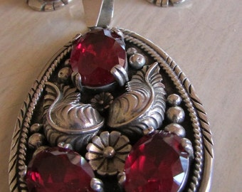 Sterling Silver Handmade Pendant and Earrings with Red Faceted Stones