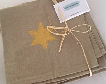 Star napkins, set of 4,  in pure cotton oatmeal colour hand painted with metallic gold stars.